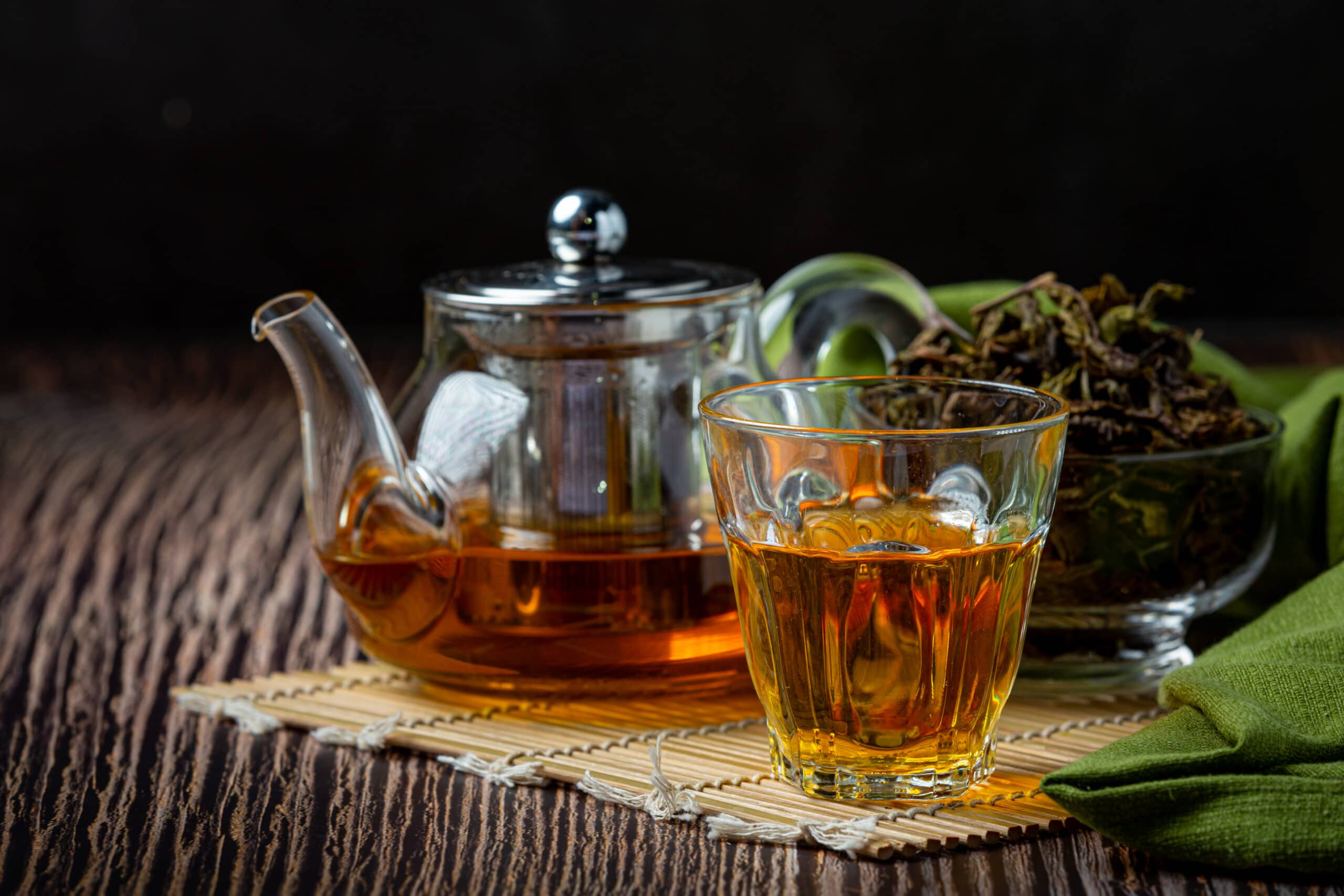 Oolong green tea in a teapot and bowl.