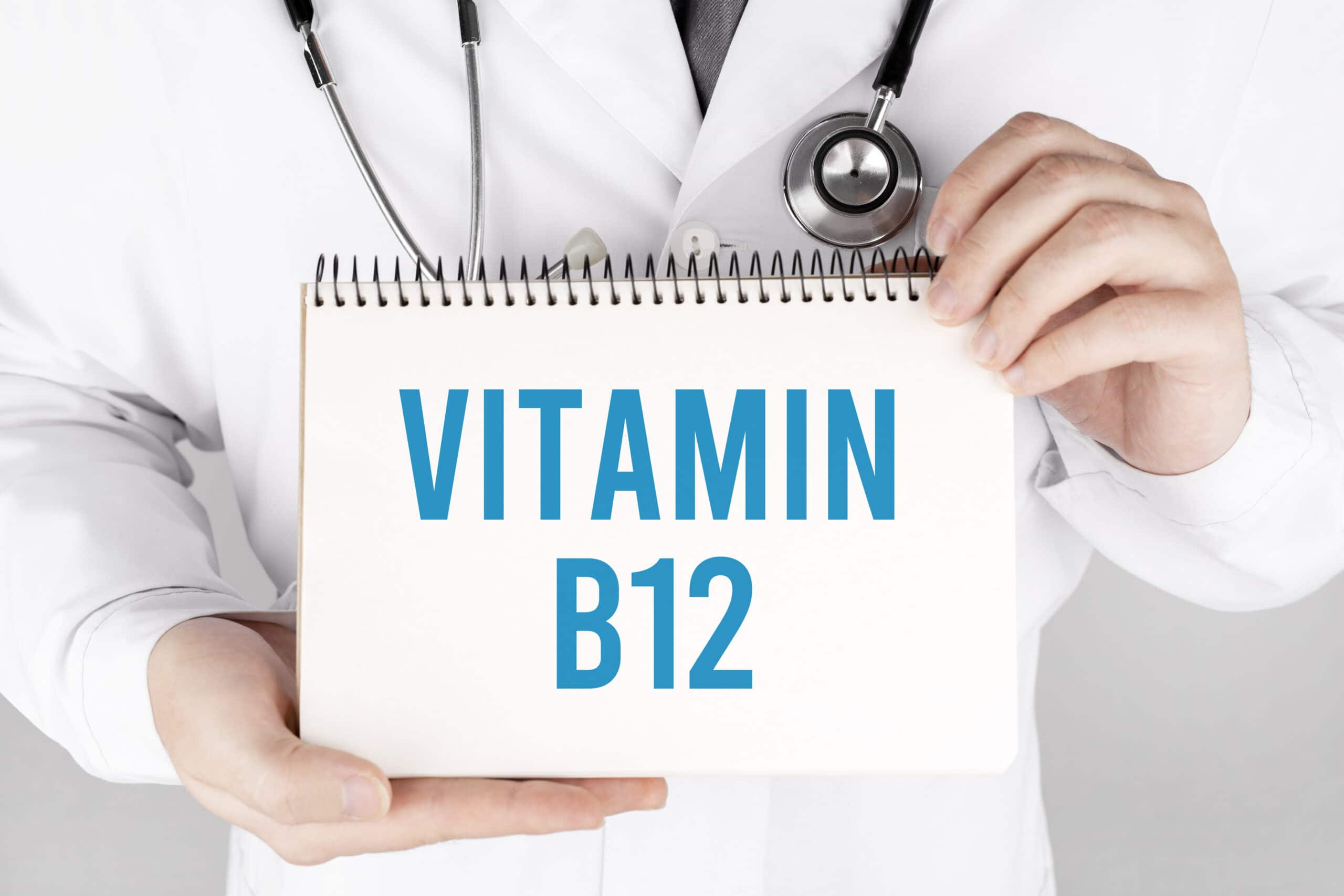 Doctor holding a card with text Vitamin B12, medical concept