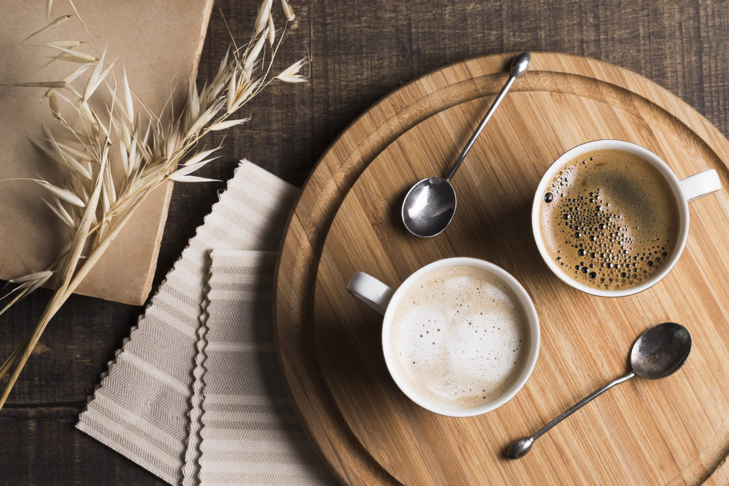 top-view-coffee-latte-white-mugs-wooden-board
